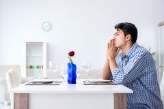The man alone preparing for romantic date with his sweetheart. Man alone preparing for romantic date with his sweetheart Stock Images