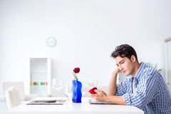 The man alone preparing for romantic date with his sweetheart. Man alone preparing for romantic date with his sweetheart Stock Photos
