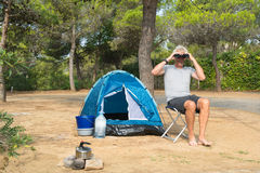 Man alone with tent for adventure camping Royalty Free Stock Images