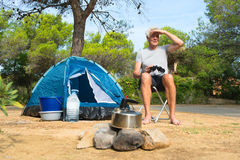 Man alone with tent for adventure camping Royalty Free Stock Image