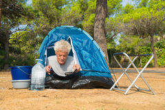 Man alone with tent for adventure camping Royalty Free Stock Photo