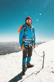 Man alpinist climbing in mountains glacier. Travel Lifestyle endurance concept adventure active vacations outdoor mountaineering sport ice axe crampons alpinism Royalty Free Stock Images