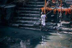 Man at alter, Nepal