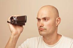 Man with amateur digital videocamera Stock Image