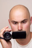 Man with amateur digital videocamera Royalty Free Stock Images