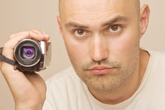 Man with amateur digital videocamera Stock Images