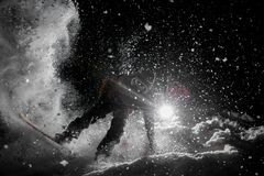Man amazingly riding snowboard in the dark under the snow Royalty Free Stock Photo