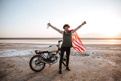 Man in american flag cape with hands up in air Royalty Free Stock Photos