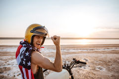 Man in american flag cape showing biceps Royalty Free Stock Image