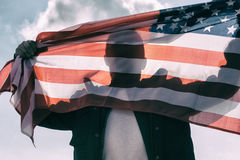 Man with American flag. Caught with hands Stock Image