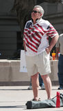 Man in American Flag decorated shirt. Patriotic man attends rally Stock Images