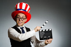 The man with american hat and movie board Royalty Free Stock Photography