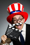The man with american hat and movie board Stock Photography