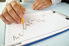 Man analysing an upward trending graph Stock Images