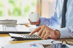Man Analysis Business Accounting with hands  pressing calculator Stock Image