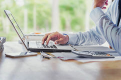 Man Analysis Business Accounting with hands  pressing laptop but Royalty Free Stock Images