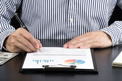 Man Analysis Business and financial report. Royalty Free Stock Images