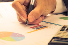 Man Analysis Business and financial report. Royalty Free Stock Image