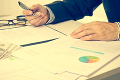 Man Analysis Business and financial report.money. Man Analysis Business and financial report Stock Image