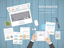 Man analyzes documents. Accounting, analytics, analysis, report, research, planning concept. Hands on the desktop hold tablet. Charts, diagrams, graphs on the Stock Photos