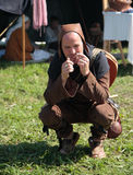 Man in ancient clothes plays the jew's harp Stock Images