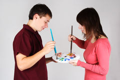 Man And Girl Mixing Paint On Palette Stock Photography