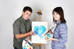 Man And Girl Painting Heart Royalty Free Stock Photography