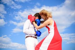 Free Man And Woman Boxing Gloves Fight Sky Background. She Knows How To Defend Herself. Girl Confident In Strength Power Royalty Free Stock Images - 129060689