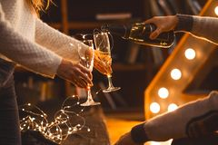 Free Man And Woman Drink Champagne In A Cozy Room In The Evening Setting Royalty Free Stock Photography - 159376287
