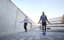 Man And Woman Exercising With Jump-rope Outdoors Stock Photography