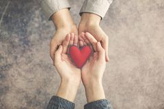Free Man And Woman Hands Together With Red Heart Stock Images - 111012704