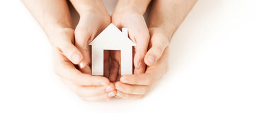Man And Woman Hands With White Paper House Stock Photos