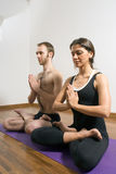 Man And Woman In Yoga Position - Vertical Stock Image