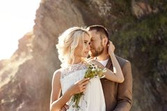 Free Man And Woman Love And Hugs, Close Relationship And Love, Couple In Love Standing On The Rocks Near The River Kissing And Cuddling Royalty Free Stock Image - 130623736