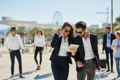 Free Man And Woman On Business Trip Using Tablet Stock Photo - 98915760