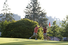 Man And Woman On Golf Course - Horizontal Royalty Free Stock Images