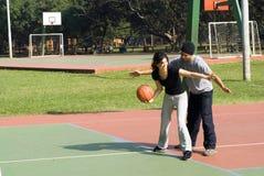 Man And Woman Playing Basketball - Horizontal Royalty Free Stock Image