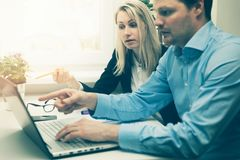 Man And Woman Working Together In Office Stock Photo
