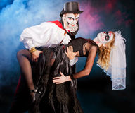Man andwoman wearing  as  vampire  and witch. . Halloween. Young men   wearing  as  vampire . Halloween Stock Images