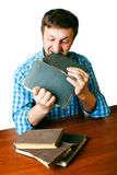Man with anger biting book Stock Image
