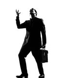 Man  anger complaigning adversity despair. Silhouette caucasian business man  expressing anger adversity despair looking up behavior full length on studio Stock Image