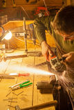 Man with angle grinder Royalty Free Stock Photography