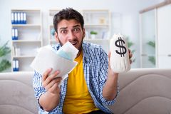 The man angry at bills he needs to pay Royalty Free Stock Photos