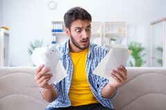 The man angry at bills he needs to pay Stock Photos