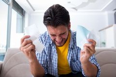 The man angry at bills he needs to pay Stock Image