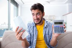 The man angry at bills he needs to pay Stock Photography