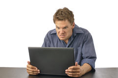 Man angry with computer Royalty Free Stock Images
