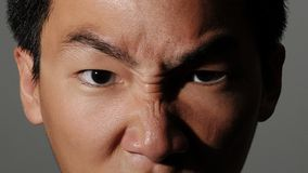 Man with angry face. A man frowning in anger Stock Photo