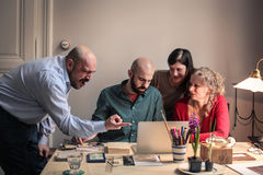 Man angry at friends over laptop Royalty Free Stock Image