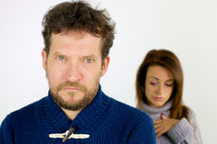 Man angry with girlfriend looking camera Royalty Free Stock Photos